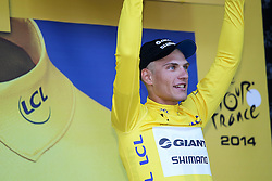© Licensed to London News Pictures. HARROGATE, ENGLAND, UK. Saturday July 5th 2014. Tour de France Yorkshire Grand Depart. Stage 1 Leeds to Harrogate. Team  Giant-Shimano rider Marcel Kittel takes the stage win and the yellow jersey. Photo credit : Chris Etchells/LNP