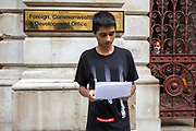 Oxfam Campaigners, Adhiyan Jeevathol, London Students for Yemen, delivering delivering a message 'Stop British bombs falling on Yemen' to the Foreign, Commonwealth and Development office on the 8th of September 2020. On the 7 July 2020 the UK Government through a written statement to Parliament reversed its decision to halt arms licensing to Saudi Arabia and announced that it will not appeal to the Supreme Court.(Photo by Andy Aitchison / Oxfam GB)