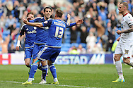 Cardiff City's Peter Whittingham (centre facing) celebrates with Craig Noone (13) after scoring his teams 2nd goal.  Skybet football league championship match, Cardiff city v Bolton Wanderers at the Cardiff city Stadium in Cardiff, South Wales on Saturday 23rd April 2016.<br /> pic by Carl Robertson, Andrew Orchard sports photography.