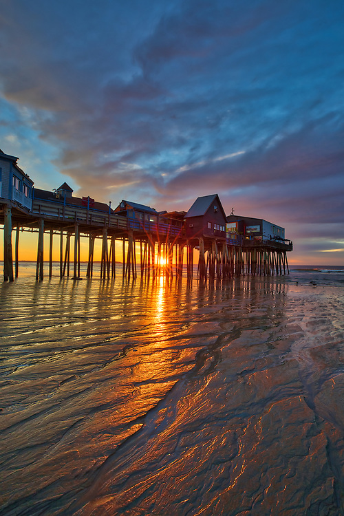 New England sunrise photography of Old Orchard Beach and its historic pier south of Portland, Maine. <br /> <br /> Maine sunrise photo images are available as museum quality photography prints, canvas prints, acrylic prints, wood prints or metal prints. Fine art prints may be framed and matted to the individual liking and decorating needs:<br /> <br /> https://juergen-roth.pixels.com/featured/sunrise-at-old-orchard-beach-with-its-iconic-pier-juergen-roth.html<br /> <br /> Good light and happy photo making!<br /> <br /> My best,<br /> <br /> Juergen<br /> Photo Prints: http://www.rothgalleries.com<br /> Photo Blog: http://whereintheworldisjuergen.blogspot.com<br /> Instagram: https://www.instagram.com/rothgalleries<br /> Twitter: https://twitter.com/naturefineart<br /> Facebook: https://www.facebook.com/naturefineart