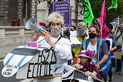 London, UK. 4th September, 2020. Activists from HS2 Rebellion, an umbrella campaign group comprising longstanding campaigners against the HS2 high-speed rail link as well as Extinction Rebellion activists, march along Whitehall with the handmade Boris the Bank Engine to a protest rally in Parliament Square. The rally, and a later protest action at the Department of Transport during which activists glued themselves to the doors and pavement outside and sprayed fake blood around the entrance, coincided with an announcement by HS2 Ltd that construction of the controversial £106bn high-speed rail link will now commence.