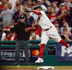 October 5, 2017 - Cleveland, OH, UKR - Cleveland Indians first baseman Carlos Santana attempts to catch a wild throw after the New York Yankees' Aaron Judge advances on a wild pitch in the fourth inning in Game 1 of the American League Division Series on Thursday, Oct. 5, 2017, at Progressive Field in Cleveland. (Credit Image: © Leah Klafczynski/TNS via ZUMA Wire)