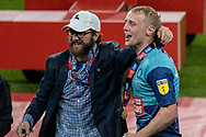 Pete Couhig Wycombe Wanderers Chief Financial Officer and nephew of owner Rob Couhig celebrates with Wycombe Wanderers defender Jack Grimmer (19) during the EFL Sky Bet League 1 Play Off Final match between Oxford United and Wycombe Wanderers at Wembley Stadium, London, England on 13 July 2020.