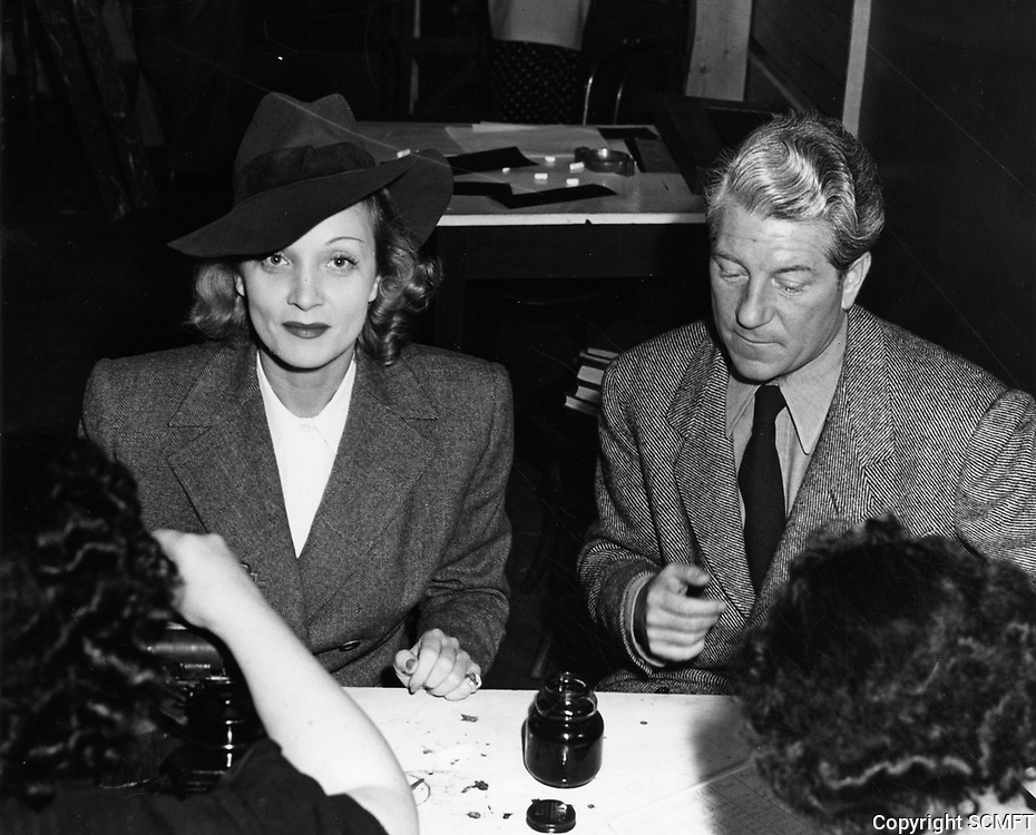 10/5/42 Marlene Dietrich & Jean Gabin register as hostess and host at the Hollywood Canteen.