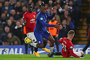Forward Michy Batshuayi of Chelsea  and Defender Luke Shaw of Manchester United compete for the ball during the English Premier League match between Chelsea and Manchester United at Stamford Bridge, Monday, Feb. 17, 2020, in London, United Kingdom. Manchester United defeated Chelsea 2-0. (Mitchell Gunn/Image of Sport)