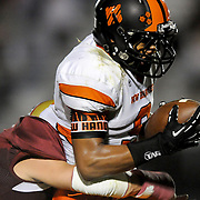 New Hanover's Rome Murphy rushes against Ashley's Corey Lawson. (Jason A. Frizzelle)