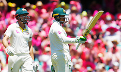 Australia's Usman Khawaja celebrates his 150 during day two of the Ashes Test match at Sydney Cricket Ground.