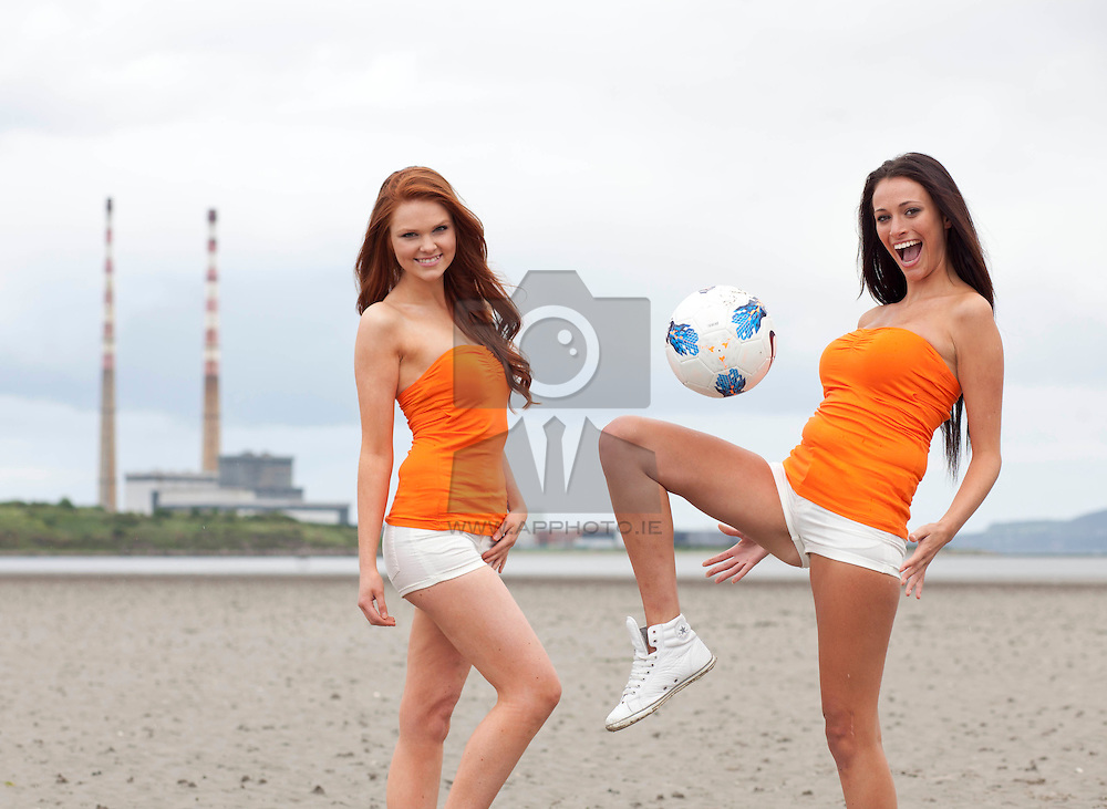 No fee for Repro: 17/06/2012.Irish Model Aoife Lennon and Italian model Kyla Flaiani are pictured launching Fisioline, one of Italy's best selling cellulite treatments. The models engaged in a friendly kick-around on Sandymount Strand to show how Fisoline can now help Irish women have even better bodies. A survey by Fisoline entitled 'You and Your Body' showed that 68.5% of Irish Women think Italian women are winners in the looks department. Picture: Jason Clarke Photography
