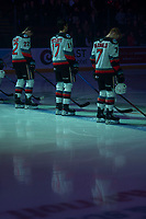 KELOWNA, BC - JANUARY 24: Dillon Hamaliuk #22, Alex Swetlikoff #17 and Conner McDonald #7 of the Kelowna Rockets line up on the blue line during the national anthems against the Seattle Thunderbirds at Prospera Place on January 24, 2020 in Kelowna, Canada. (Photo by Marissa Baecker/Shoot the Breeze)