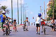 Israel, Children enjoy the empty street to ride bicycles during Yom Kippur. Virtually all traffic stop during the Jewish holiday on Yom Kippur