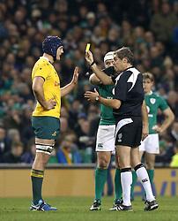 Australia's Dean Mumm receives a yellow card from referee Jerome Garces during the Autumn International match at the Aviva Stadium, Dublin.