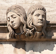 Two womens head Gargoyle below Magdalen Great Tower, part of Magdalen College, Oxford University, England.