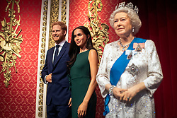 "The figures of the Duke and Duchess of Sussex in their original positions next to Queen Elizabeth II, as Madame Tussauds London moved its figures of the couple from its Royal Family set to elsewhere in the attraction, in the wake of the announcement that they will take a step back as ""senior members"" of the royal family, dividing their time between the UK and North America."