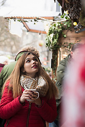 Young woman drinking hot wine