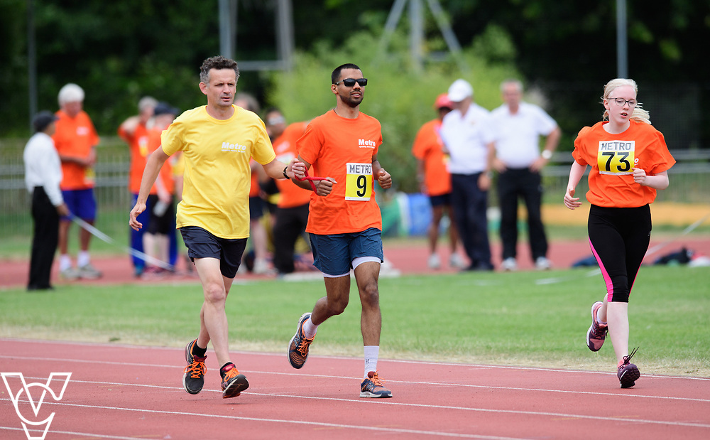 Event: 1500 meters<br /> Competitors, from left: Naqi Rizvi and Emma Quigley<br /> <br /> Metro Blind Sport's 42nd Athletics Open, held at Mile End Stadium, Tower Hamlets, London.<br /> <br /> Picture: Chris Vaughan Photography for Metro Blind Sports<br /> Date: June 16, 2018