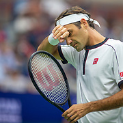 2019 US Open Tennis Tournament- Day Three. Roger Federer of Switzerland during his match against Damir Dzumhur of Bosnia and Herzegovina in the Men's Singles Round Two match on Arthur Ashe Stadium at the 2019 US Open Tennis Tournament at the USTA Billie Jean King National Tennis Center on August 27th, 2019 in Flushing, Queens, New York City.  (Photo by Tim Clayton/Corbis via Getty Images)