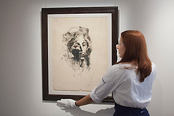© Licensed to London News Pictures. 13/09/2013. London, UK. A Sotheby's employee adjusts 'Portrait de Femme a la Mantie' (1905) (est. GB£60,000-80,000), Pablo Picasso's first known monotype, at the press view for Sotheby's 'Prints and Multiples Sale' on New Bond Street in London today (13/09/2013). The auction, set to take place on the 17th of September, includes works by Munch, Rembrandt, Basquiat, Warhol and Picasso. Photo credit: Matt Cetti-Roberts/LNP
