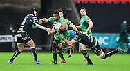 Connacht's Naulia Dawai is tackled by Ospreys' Justin Tipuric ®.<br /> <br /> Guinness Pro12 rugby match, Ospreys v Connacht rugby at the Liberty Stadium in Swansea, South Wales on Saturday 7th January 2017.<br /> pic by Craig Thomas, Andrew Orchard sports photography.
