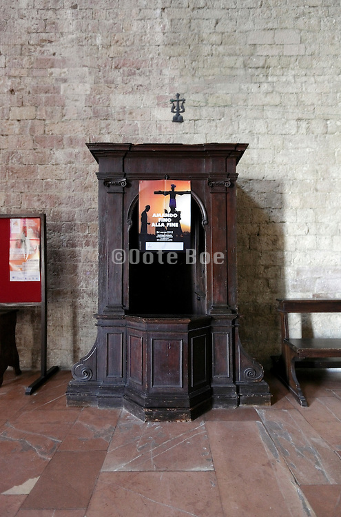confessional covered with a announcement poster Italy