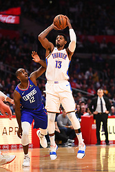 October 19, 2018 - Los Angeles, CA, U.S. - LOS ANGELES, CA - OCTOBER 19: Oklahoma City Thunder Forward Paul George (13) shoots over Los Angeles Clippers Forward Luc Mbah a Moute (12) during a NBA game between the Oklahoma City Thunder and the Los Angeles Clippers on October 19, 2018 at STAPLES Center in Los Angeles, CA. (Credit Image: © Brian Rothmuller/Icon SMI via ZUMA Press)