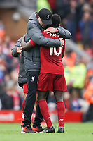 Football - 2019 / 2020 Premier League - Liverpool vs. AFC Bournemouth<br /> <br /> Liverpool manager Jürgen Klopp hugs Liverpool's Sadio Mane at the end of the match, at Anfield.<br /> <br /> <br /> COLORSPORT/TERRY DONNELLY