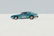 Best cars-people-atmosphere-photos of 2009 Bonneville Speed Week- Due Cento's 1963 Studebaker, owned and driven by Jim Lange of Effingham, IL. makes a run at the Bonneville Speed Way. August 9, 2009.  Photo by Colin E. Braley