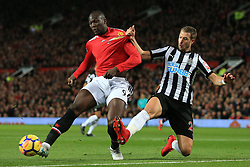 18th November 2017 - Premier League - Manchester United v Newcastle United - Florian Lejeune of Newcastle pulls at the shirt of Romelu Lukaku of Man Utd - Photo: Simon Stacpoole / Offside.