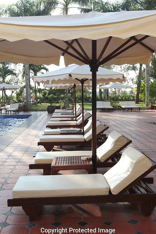 The pool area at the Victoria  Hotel in Can Tho Vietnam. Photograph byDennis Brack