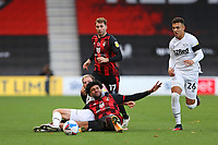 Football - 2020 / 2021 Sky Bet Championship - AFC Bournemouth vs. Derby County - The Vitality Stadium<br /> <br /> Matt Clarke of Derby and Bournemouth's Philip Billing end up on the floor after tussling for the ball during the Championship match at the Vitality Stadium (Dean Court) Bournemouth  <br /> <br /> COLORSPORT/SHAUN BOGGUST
