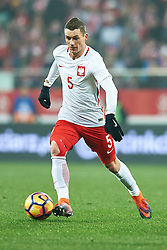 Wroclaw, Poland - 2016 November 14: Krzysztof Maczynski of Poland controls the ball during Poland v Slovenia - International Friendly Soccer Match at Municipal Stadium on November 14, 2016 in Wroclaw, Poland.<br /> <br /> Adam Nurkiewicz declares that he has no rights to the image of people at the photographs of his authorship.<br /> <br /> Picture also available in RAW (NEF) or TIFF format on special request.<br /> <br /> Any editorial, commercial or promotional use requires written permission from the author of image.<br /> <br /> Mandatory credit:<br /> Photo by © Adam Nurkiewicz / Mediasport