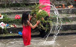KATHMANDU, Sep. 6, 2016 (Xinhua) -- Hindu women participate in a bath ritual to clean themselves on the bank of Bagmati River during the Rishi Panchami festival in Kathmandu, Nepal, Sep. 6, 2016. Rishi Panchami festival marks the end of the three-day Teej festival when women worship Sapta Rishi (Seven Saints) and pray for health for their husbands while unmarried women wish for handsome husbands and happy conjugal lives. (Xinhua/Sunil Sharma).****Authorized by ytfs* (Credit Image: © Sunil Sharma/Xinhua via ZUMA Wire)