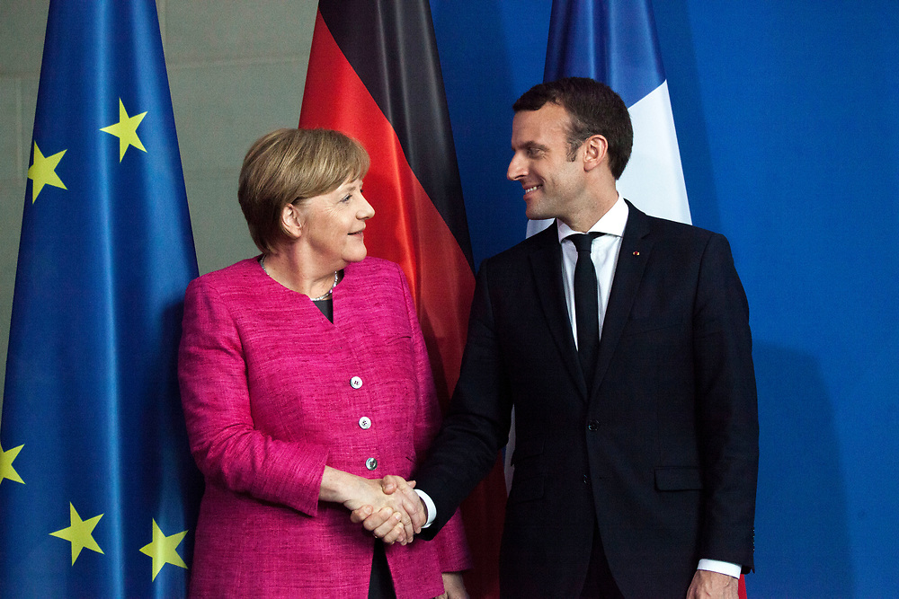 The German Chancellor Angela Merkel , and the French President Emmanuel Macron  are seen during a joint press conference at the chancellery in Berlin, as part of Macron first official visit as President to Germany, on  Monday, May 15, 2017. (Photo by Omer Messinger)