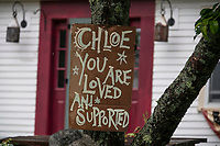 Community support is reflected in signs in front of homes along Belknap Mountain Road in Gilford on Tuesday.  (Karen Bobotas/for the Laconia Daily Sun)