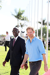 Prince Harry and Antigua and Barbuda's sports minister Colin James arrive at a youth sports festival at the Sir Vivian Richards Stadium in North Sound, Antigua, on the second day of his tour of the Caribbean.
