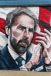 © Licensed to London News Pictures. 14/07/2021. London, UK. A mural of England football team including manager GARETH SOUTHGATE and footballers HARY KANE and RAHEEM STIRLING has been unveiled near London. Bridge. The mural created by Marc Silver of MurWalls, is a celebration of a team that has united the nation. Photo credit: Ray Tang/LNP