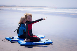 Boy showing something to his sister on the beach, Viana do Castelo, Norte Region, Portugal