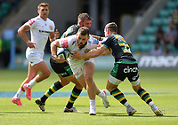 Rugby Union - 2020 / 2021 Gallagher Premiership - Round 21 - Northampton Saints vs Exeter Chief - Franklin Gardens.<br /> <br /> Exeter Chiefs' Luke Cowan-Dickie is tackled by Northampton Saints' Rory Hutchinson.<br /> <br /> COLORSPORT/ASHLEY WESTERN