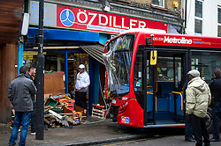 © Licensed to London News Pictures. 09/01/2016. London, UK. The scene in Camden, north London, where a bus has crashed in to the front of a shop causing serious damage to the shop front and the bus. Photo credit: Ben Cawthra/LNP