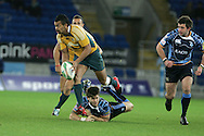 Cardiff Blues v Australia at the Cardiff City Stadium on Tuesday 24th Nov 2009. pic by Andrew Orchard, Andrew Orchard sports photography. Kurtley Beale of Australia is tackled.