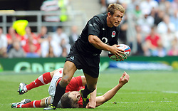 Photo © SPORTZPICS / SECONDS LEFT IMAGES 2011 - Rugby Union - Investic - World Cup warm up game - England V Wales - 06/08/11 - England's Jonny Wilkinson slips a tackle by Wales' Ryan Jones to open an attack - at Twickenham Stadium UK - All rights reserved