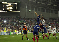 Photo: Richard Lane.<br />France v England. Semi-Final, at the Telstra Stadium, Sydney. RWC 2003. 16/11/2003. <br />Imanol Harinordoquy is challenged by Ben Kay late in the game with the final score 24-7.