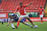 K Bielik is challenged by Ethan Hamilton during the EFL Sky Bet League 1 match between Charlton Athletic and Rochdale at The Valley, London, England on 4 May 2019.