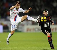 FOOTBALL - FRENCH CHAMPIONSHIP 2010/2011 - L1 - OLYMPIQUE LYONNAIS v STADE RENNAIS - 19/03/2011 - PHOTO JEAN MARIE HERVIO / DPPI - YOANN GOURCUFF (OL) / JEROME LEROY (SR)