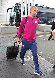 Pep Guardiola commits the ultimate sin of football team travel and forgets his passport. Pep got off the team bus and looked in his bag before getting back on the bus for 30 minutes while his passport was located and delivered in a chauffeur driven Mercedes Pep goes into the terminal for the 1st time before going back to the bus as the Manchester City team arrive at Manchester Airport as they jet for Iceland