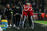 Swansea city caretaker manager Alan Curtis ® shows his delight as he celebrates with his coaching staff at the final whistle after his team win 1-0. Barclays Premier league match, Swansea city v West Bromwich Albion at the Liberty Stadium in Swansea, South Wales  on Boxing Day Saturday 26th December 2015.<br /> pic by  Andrew Orchard, Andrew Orchard sports photography.