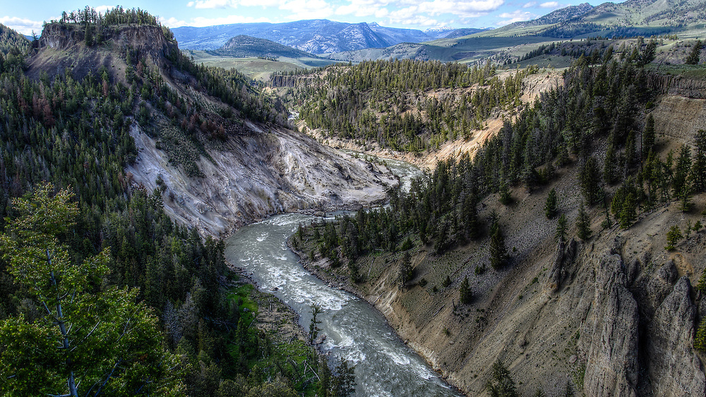 Yellowstone National Park, Wyoming.The area on the left is calcite from volcanic vents and actually looks just like that. Bleached white on the hillside. That's why I chose this particular valley. It showed both the grandeur and the activity that is Yellowstone.
