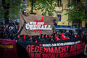 """01/05/2015 – Berlin, Germany: Members of Anarchist groups march on the streets of Berlin during the """"Revolutionary 1st of May Demonstrations"""" in Kreuzberg to mark the Workers Day. The International Workers Day is a celebration of laborers and the working classes that is promoted by the international labor movement, anarchists, socialists, and communists and occurs every year on May Day. (Eduardo Leal)"""