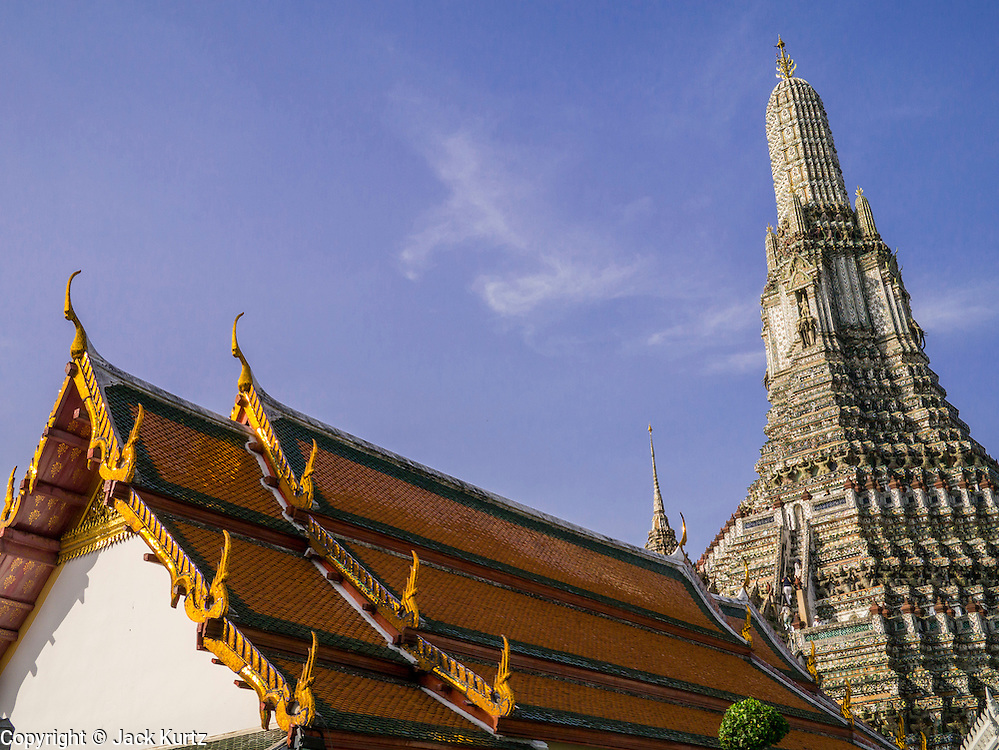 """19 OCTOBER 2012 - BANGKOK, THAILAND:    The roofline and prang of Wat Arun, the """"Temple of the Dawn"""" in Bangkok, Thailand. Wat Arun is one of the most historic temples in Bangkok. It's Chedi is built in the Khmer (Cambodian) style and called a Prang.        PHOTO BY JACK KURTZ"""