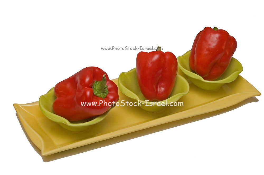 Three Red pepper in 3 dishes and a tray still life on a white background