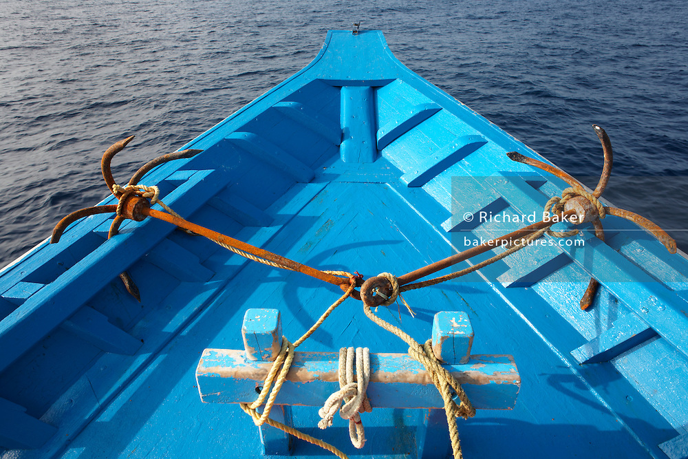 Two-sided anchor is spread across the bow deck of  a traditional dhoni tuna fishing boat on the Indian Ocean, Maldives.